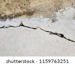 cracked concrete road texture | Shutterstock . vector #1159763251
