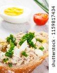 closeup of crusty baguette with ... | Shutterstock . vector #1159817434