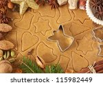 Homemade christmas cookies, angel cutter and spices. - stock photo