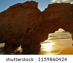 a natural door in a cliff at a... | Shutterstock . vector #1159860424