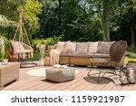 pouf and rattan chair on wooden ... | Shutterstock . vector #1159921987