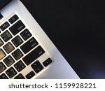 keyboard notebook on black desk | Shutterstock . vector #1159928221