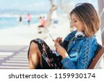 young woman relaxing on a bench ... | Shutterstock . vector #1159930174