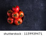 red  ripe tomatoes on a dark... | Shutterstock . vector #1159939471