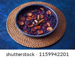 oven baked plums with cinnamon... | Shutterstock . vector #1159942201