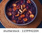 oven baked plums with cinnamon... | Shutterstock . vector #1159942204
