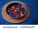 oven baked plums with cinnamon... | Shutterstock . vector #1159942207