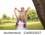happy mother with son in green... | Shutterstock . vector #1160023027