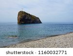 a small island with a cross in... | Shutterstock . vector #1160032771