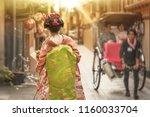 cute japanese geisha girl in... | Shutterstock . vector #1160033704