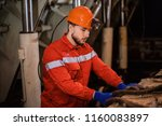 a young miner in a coal mine in ... | Shutterstock . vector #1160083897