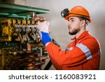a young miner in a coal mine in ... | Shutterstock . vector #1160083921