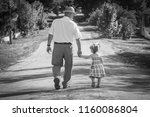 a grandfather with the grandson ... | Shutterstock . vector #1160086804