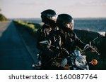 couple of bikers in helmets... | Shutterstock . vector #1160087764