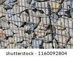 close up view of a steel gabion ... | Shutterstock . vector #1160092804