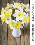 white daffodils at china vase... | Shutterstock . vector #1160097334
