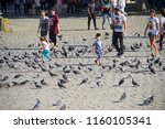people and children are playing ... | Shutterstock . vector #1160105341