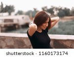 attractive woman fixed her... | Shutterstock . vector #1160173174