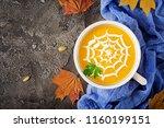 pumpkin soup in a bowl served... | Shutterstock . vector #1160199151