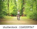 girl bicycle   little baby girl ... | Shutterstock . vector #1160209567