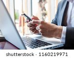 businessman in black suit using ... | Shutterstock . vector #1160219971