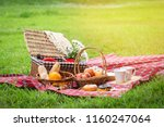 Picnic Basket With Fruit And...