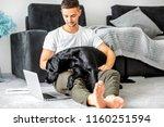 freelancer guy sitting at home... | Shutterstock . vector #1160251594