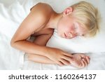 blondy boy sleeping in bed.... | Shutterstock . vector #1160264137