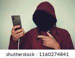 faceless unrecognizable hooded...   Shutterstock . vector #1160274841