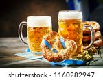 beer mugs and pretzels on a... | Shutterstock . vector #1160282947
