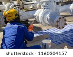 male worker painted white at... | Shutterstock . vector #1160304157