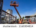 two male  industry working at... | Shutterstock . vector #1160304814