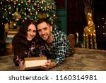 couple with christmas present | Shutterstock . vector #1160314981