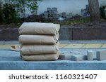four paper bags with cement are ... | Shutterstock . vector #1160321407