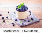 lots of fresh blueberries  ... | Shutterstock . vector #1160336401