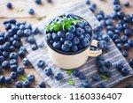 lots of fresh blueberries  ... | Shutterstock . vector #1160336407