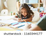 focused girl with wavy hair... | Shutterstock . vector #1160344177