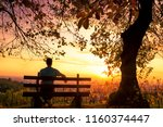 silhouette of a man sitting on... | Shutterstock . vector #1160374447