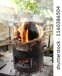 old cooking pot stove using... | Shutterstock . vector #1160386504