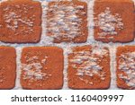 snow on the brown paving slab | Shutterstock . vector #1160409997