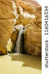 small waterfall in oasis... | Shutterstock . vector #1160416534