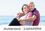 ordinary happy mature couple... | Shutterstock . vector #1160445904