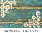 Flowers Daisy On A Wooden...