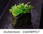 vegan sushi on black background   Shutterstock . vector #1160489917