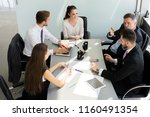 businesspeople discussing... | Shutterstock . vector #1160491354