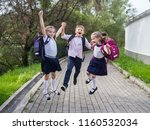 happy school children in... | Shutterstock . vector #1160532034