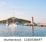 macinaggio harbour with red... | Shutterstock . vector #1160538697