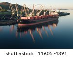 the cargo ship is in the port... | Shutterstock . vector #1160574391