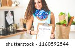 woman in the kitchen at home ...   Shutterstock . vector #1160592544