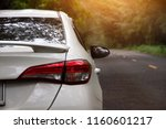 car on road morning day with... | Shutterstock . vector #1160601217